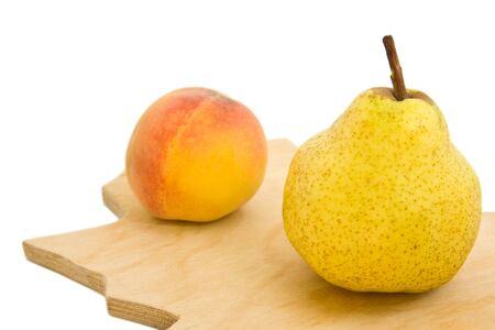 Appetizing pear and peach isolated over white photo