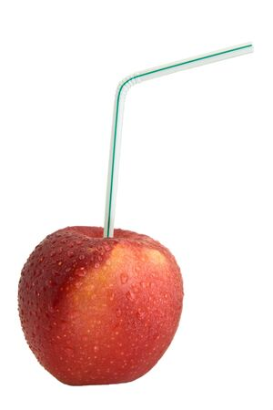 Red Apple with Drinking Straw. Juice concept photo