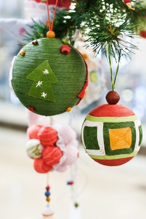 Close-up Christmas Toys and Balls on the fir tree photo