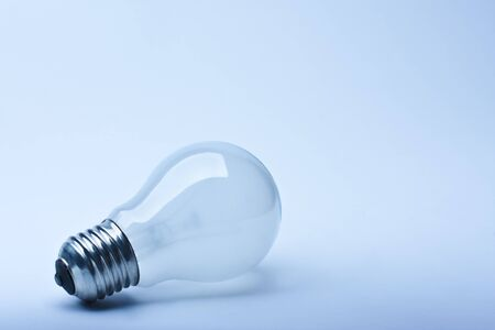 Close-up isolated light bulb in blue lighting photo