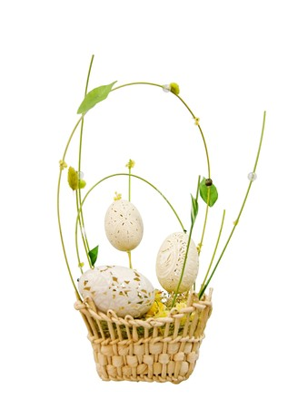 Wicker basket with decorative easter eggs isolated over white photo