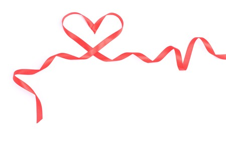 Red heart from ribbon for valentine isolated over white photo
