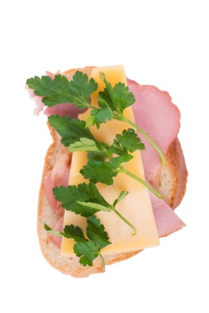 long faced: Open faced sandwich with ham, cheese and parsley isolated over white