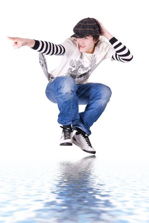 Teenage boy jumping and dancing Locking or Hip-hop dance over isolated background photo