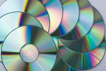 Multicolored CD disks close-up