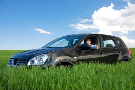 Successful businessman is thumbs-up in own car. It is best choice!
