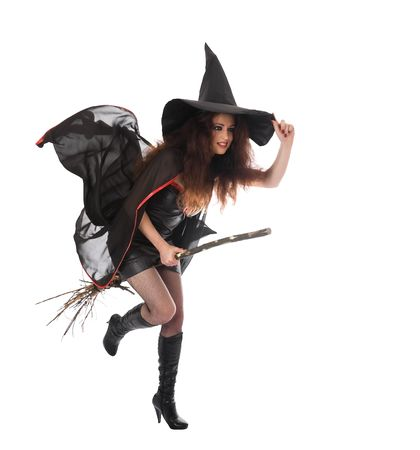 Halloween witch flying on broom. Isolated photo