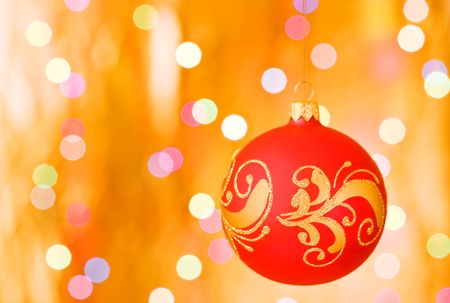Christmas decorative sphere over gold blurred background Stock Photo - 5893309