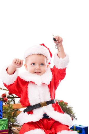 Happy toddler Santa with house or car keys photo