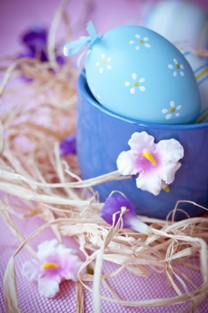 Easter eggs and flowers photo