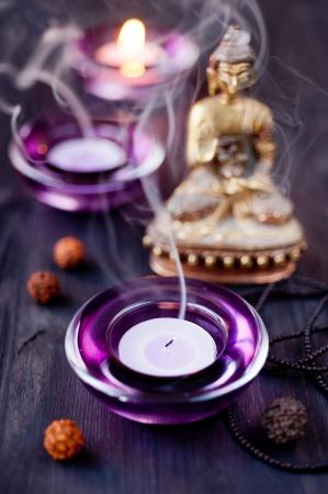 Buddha Statue and Candle photo