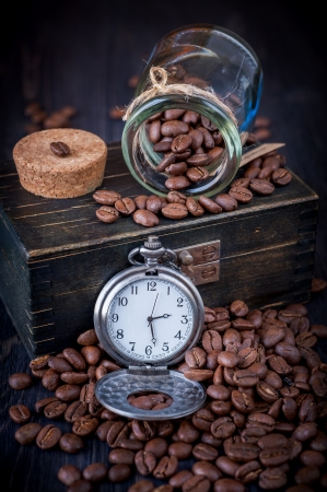 Coffee and vintage watch on a chain photo