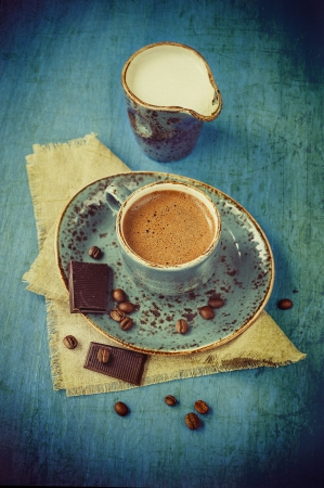 Coffee with chocolate and cream in a vintage style photo