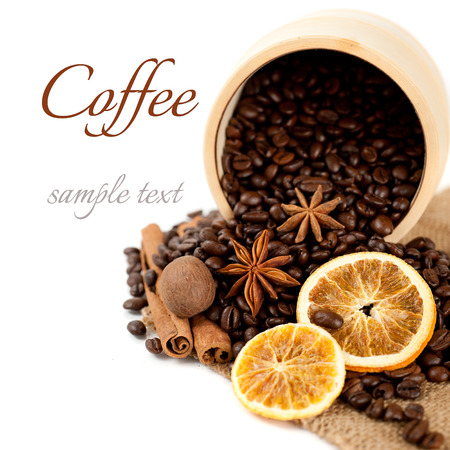 Coffee beans and spices: cinnamon, star anise and dried orange