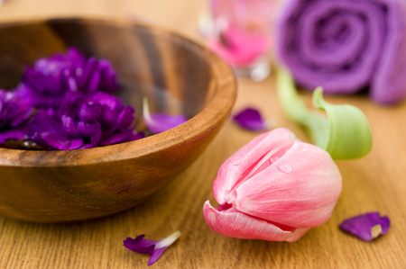 spa concept. cloves in a bowl with water, tulip,  towel and candle photo