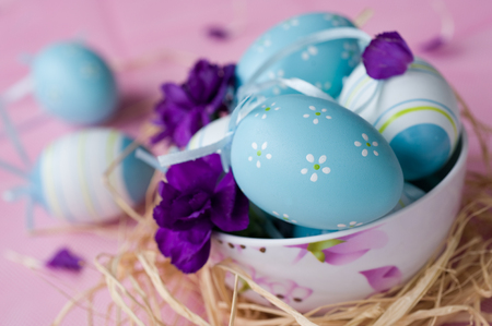 Easter eggs decorated with carnations photo