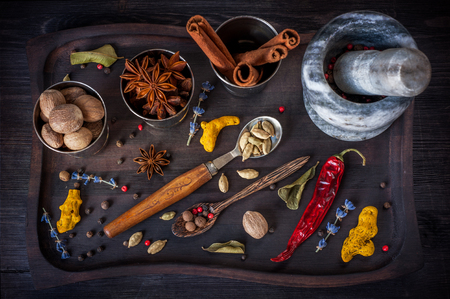 Spices. star anise, turmeric, nutmeg, cardamom, lavender, allspice and lemon grass in a vintage tray. photo
