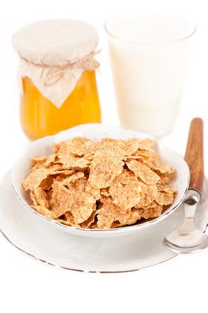 Muesli, honey and milk  photo