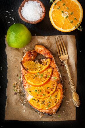 Grilled salmon steak with orange and thyme photo