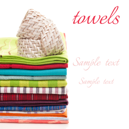 pile of towels for the kitchen on a white background photo