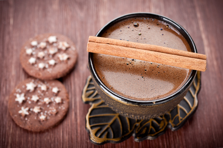 Сup of espresso with chocolate chip cookies and cinnamon photo
