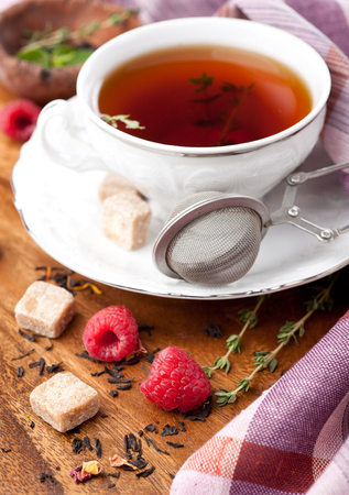 Cup of tea with herbs and berries photo