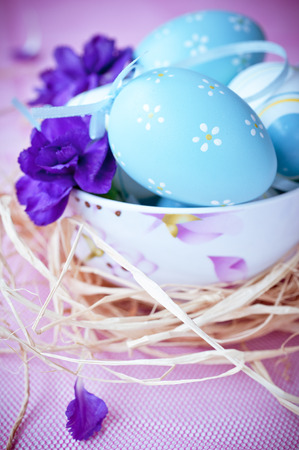 Composition with Easter eggs and flowers photo