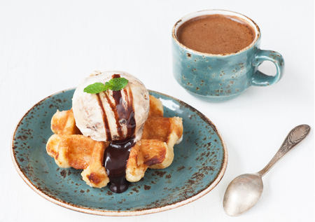 Ice cream and sweet waffle with a cup of coffee photo