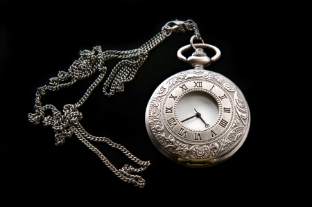 Vintage pocket watch on a black background