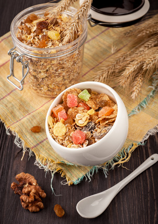Granola (muesli) with nuts and dried fruits. healthy Breakfast photo