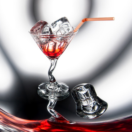 Red cocktail with ice (martini or cosmopolitan)