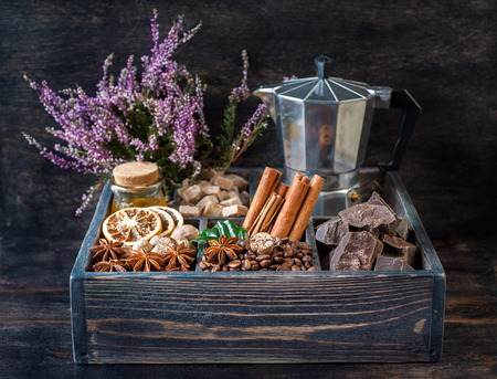 Сoffee beans, chocolate, spices and honey in a wooden box. photo