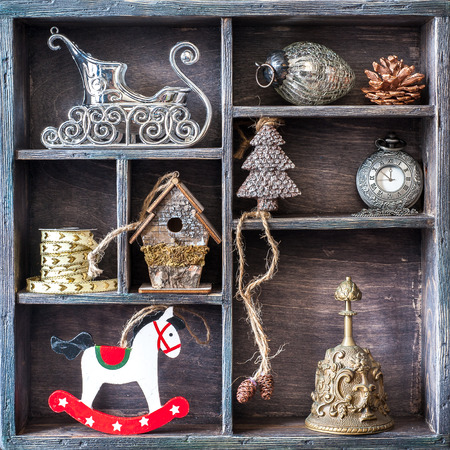 antique sleigh: Christmas retro collage with toys and decorations. Antique clocks, bell, rocking horse, Santas sleigh.
