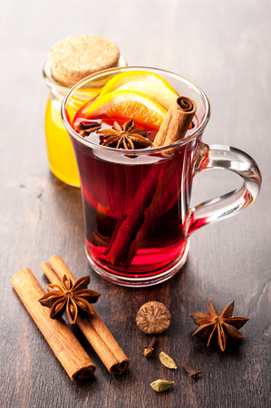 gluhwijn: Hot wine with honey and spices in a glass cup