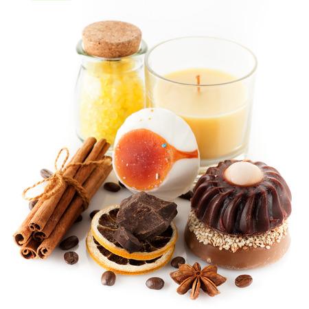Handmade soap with coffee, chocolate and cinnamon, sea salt and candle photo