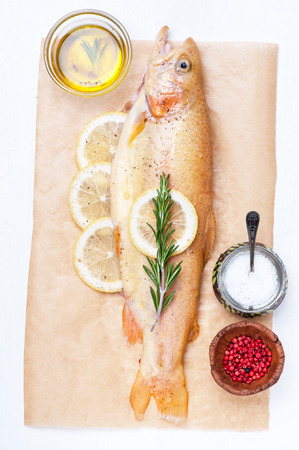 raw fish: Raw fish golden trout with herbs and spices