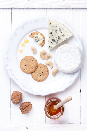 cheese plate: Cheese plate. Various types of cheese with honey and nuts.
