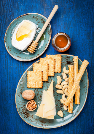 grissini: Parmesan cheese, Camembert cheese, honey,  grissini bread sticks. Cheese plate.