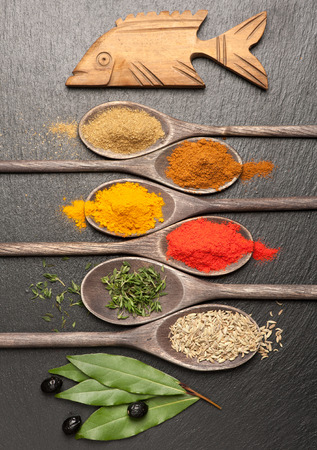 Spices and herbs on chalkboard. Spices for seafood. photo