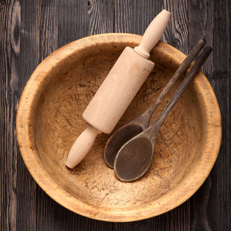Rolling pin, wooden bowls and wooden spoons. photo