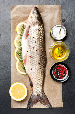 raw fish: Raw fish carp with herbs and spices
