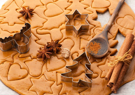 christmas baking: Christmas baking background dough, cookie cutters and  spices