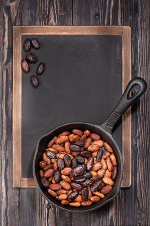 pan tropical: cocoa beans in pan and chalk board