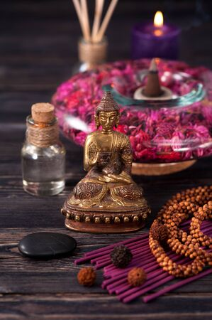 zen candles: Aromatherapy and meditation. Buddha statue, zen stones and incense Stock Photo