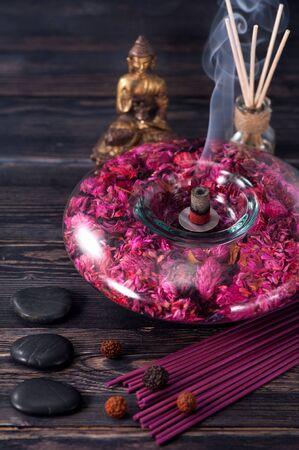 incense sticks: aromatherapy and spa. Buddha statue, stone massage and incense sticks Stock Photo
