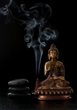 Buddha statue and stones zen. Spa and meditation concept Imagens