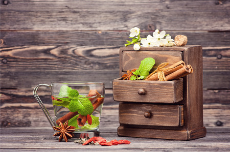 herbs boxes: Tea with mint, cinnamon, flowers and berries goji Stock Photo