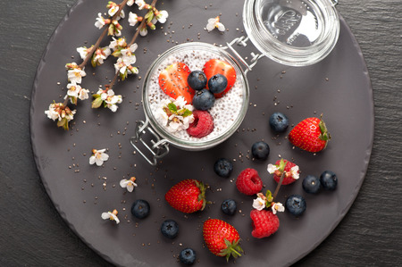summer pudding: Chia seeds pudding with coconut milk and fresh summer berries. top view Stock Photo