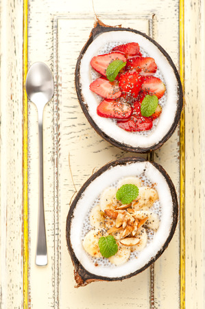 healthy grains: Chia seeds pudding dessert with banana and strawberries Stock Photo