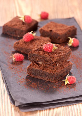 brownies: Cake chocolate brownies and raspberries